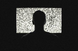 A man watching a blank tv screen