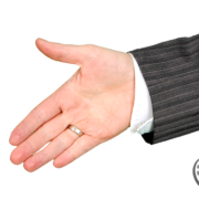 A business man extends his hand to shake yours
