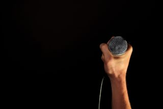 A person with a microphone in hand