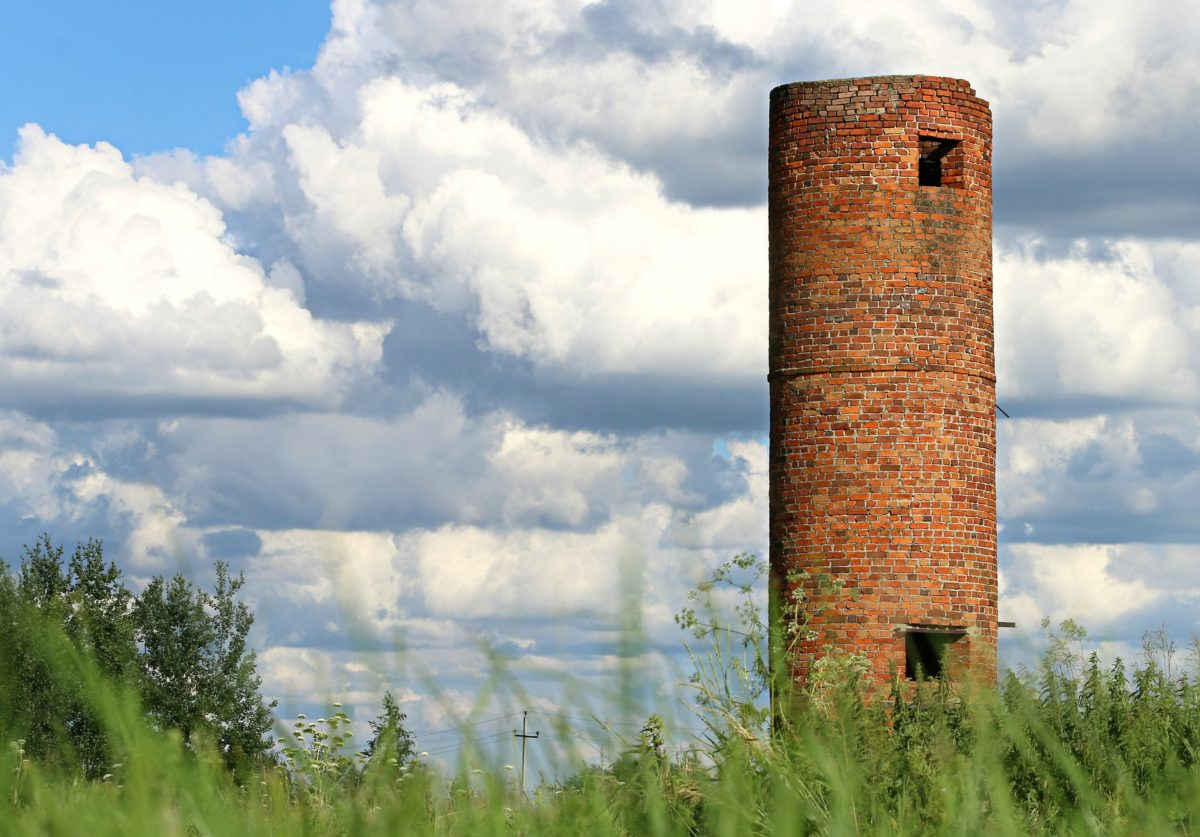 A brick tower in the country side